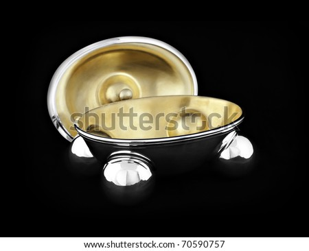 empty open bonbonniere made out of silver and gold isolated on black background - stock photo