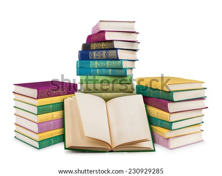 empty open book and pile of colorful vintage books on an isolated white background - stock photo