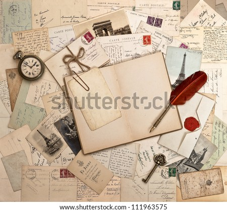 empty open book, old accessories and post cards. sentimental vintage background - stock photo