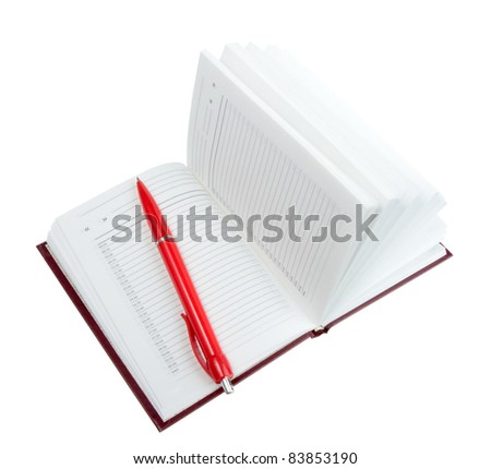 Empty open diary and red ball point pen. Close-up. Isolated on white background. Studio photography. - stock photo