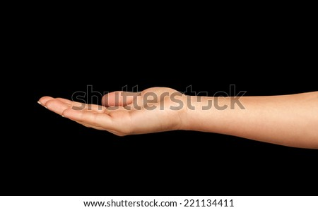 Empty open hand on a black background