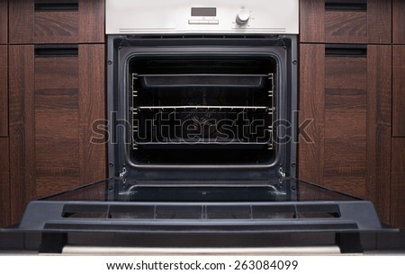 Empty open oven - stock photo