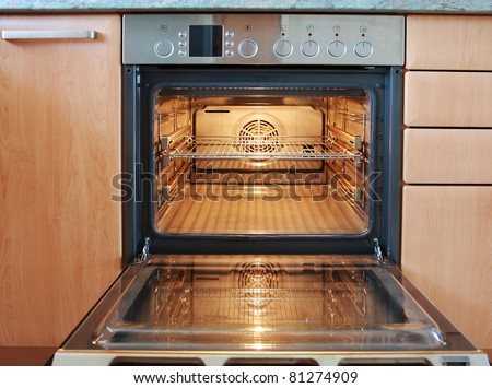 open oven in kitchen. empty open oven in kitchen a