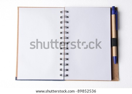 Empty opened white block notes with spiral and pen - stock photo