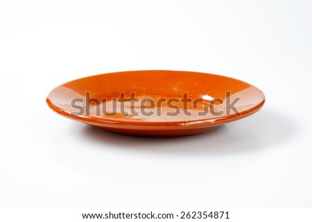 empty orange plate on white background