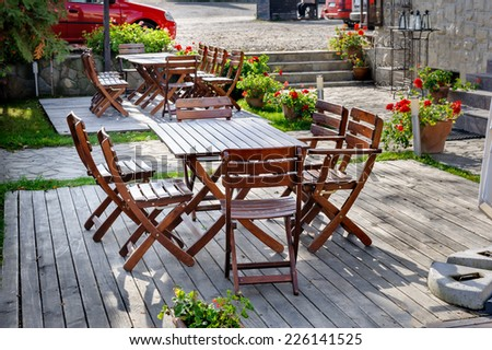 Empty outdoor cafe table - stock photo