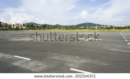 Empty outdoor parking lot - stock photo