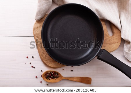 Empty pan on wooden deck table with tablecloth for pizza, product montage. Flat mock up for design. Top view. - stock photo