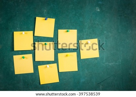 Empty paper,Note Paper,white paper Blank Yellow paper ,Blank Yellow, paper on green board with tack pin for text and background - stock photo