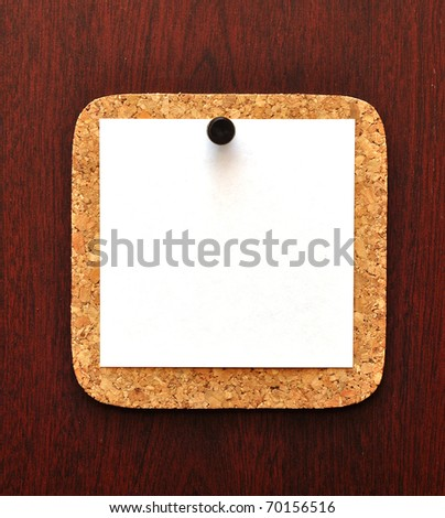 empty paper pressed the black pushpin to the wood background - stock photo