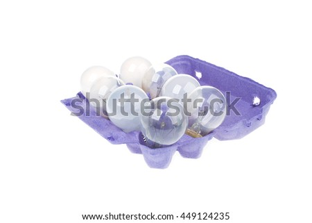 Empty Paper tray of eggs with light bulbs isolated on white background - stock photo