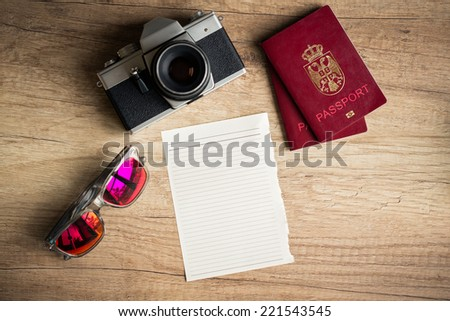 Empty paper with travel things for traveling on wooden background  - stock photo