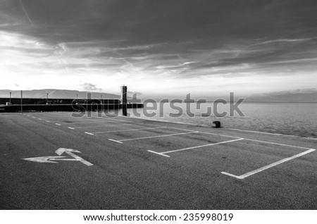 Empty parking area with sea landscape - stock photo