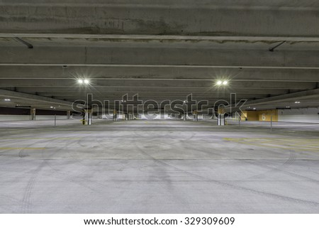 Empty parking garage at night