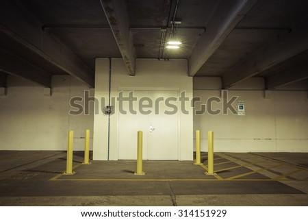 Empty parking garage metal door - stock photo