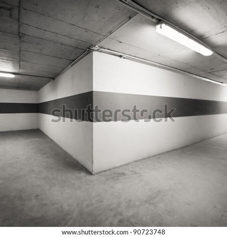 Empty parking lot area wall - stock photo
