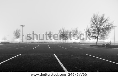 Empty parking lot at night with heavy fog
