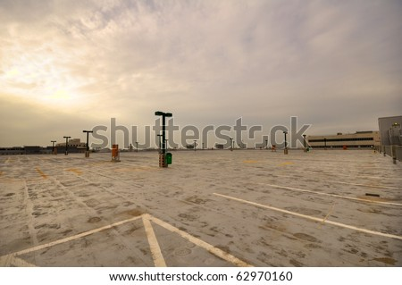 Empty parking lot in a stormy day. - stock photo