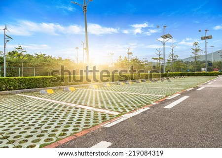 empty parking lot of city outdoor. - stock photo