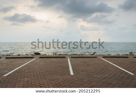 Empty parking lot with seascape  - stock photo