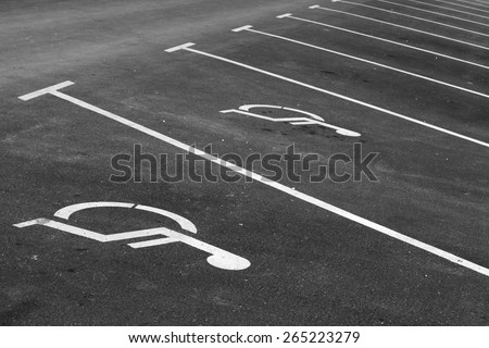 Empty parking places with handicapped or disabled signs and marking lines n asphalt - stock photo