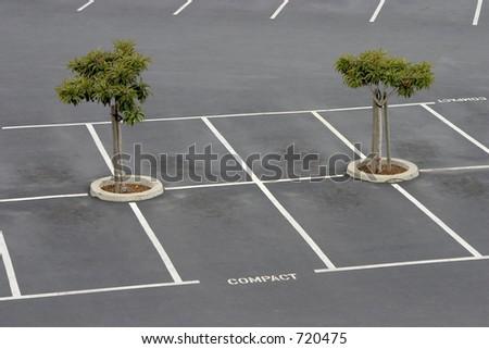 Empty parking spaces await commuters. - stock photo
