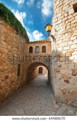 Empty passageway in Peratallada, Spain - stock photo