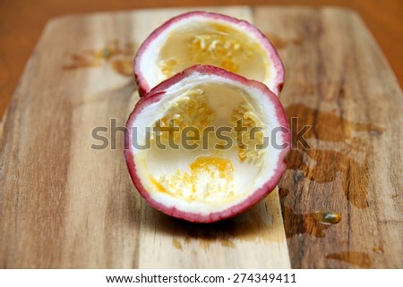 empty passion fruit on chopping board - stock photo