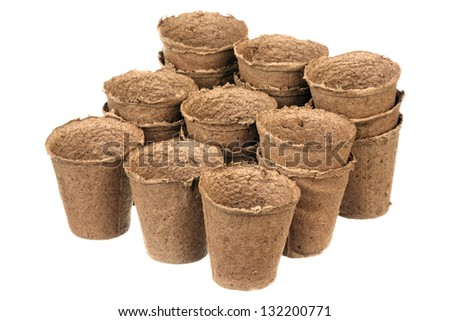 Empty peat pots isolated over white background - stock photo