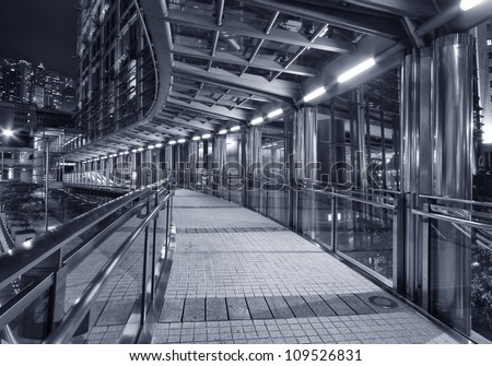 Empty pedestrian transition over busy street - stock photo