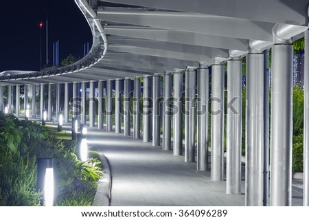 Empty pedestrian walkway in the park at night  - stock photo