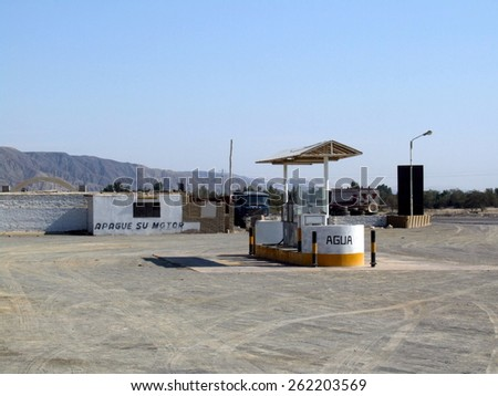 Empty petrol station in Peruvian desert on the way from Lima to Nazca - stock photo