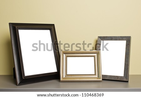 empty photo frames on old table - stock photo