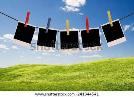 empty photo frames over sky background - stock photo