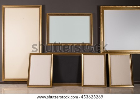 Empty photograph frames in gallery