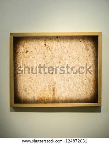 Empty picture frame on gallery wall - stock photo