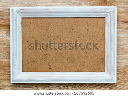 empty picture frame on wooden background - stock photo