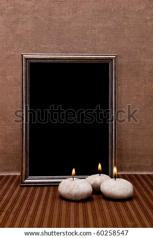 Empty picture frame with candles - stock photo