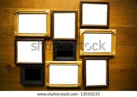 empty picture frames on wooden wall - stock photo