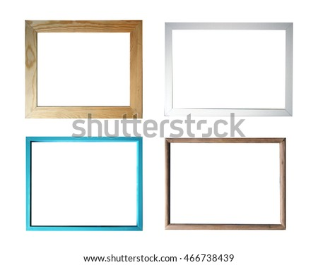 Empty picture frames over white background