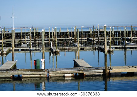 Empty pier is awaiting boats - stock photo