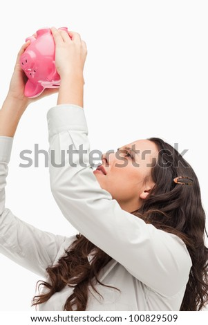 Empty piggy bank against white background