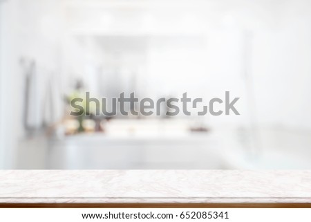Empty pink marble top table for product display montage with blurred bathroom interior Bckground.