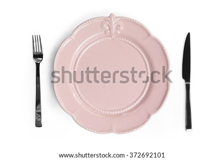 Empty pink plate with a knife and fork