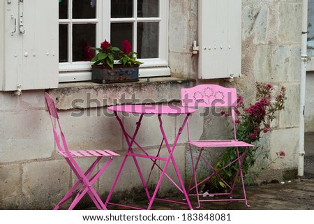 Empty pink table in the cafe during the rain - stock photo