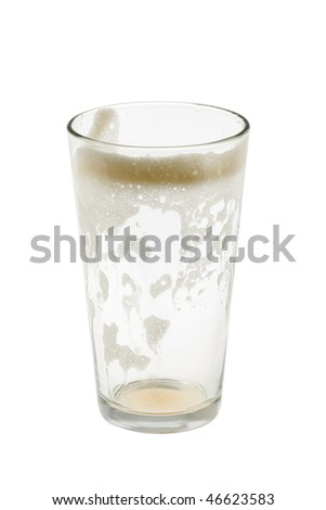 Empty pint glass with foam on white background - stock photo
