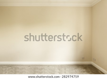 Empty plain painted room in a house with no furniture