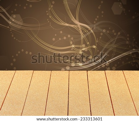 Empty plain wooden table backed with swirling light trails and party bokeh for your product or food placement or promotion for a festive occasion - stock photo