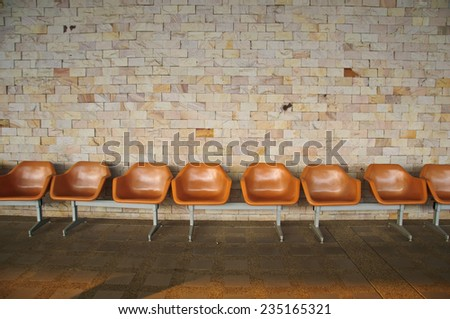 Empty Plastic Chairs on stone background - stock photo