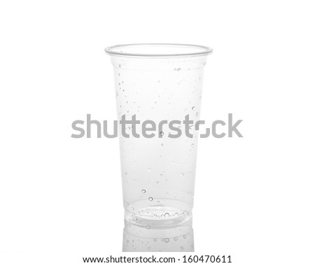 Empty plastic cup isolated on a white background. - stock photo